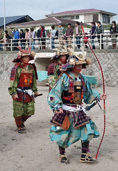 Three men dressed in samurai armour walking on the beach #samurai