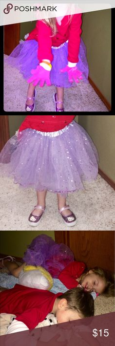 💟Purple Sparkling Taffeta TuTu💟 That's my daughter, such a princess! She would be perfectly happy to never take it off but she's outgrown it & as devastating as it is, it's time to pass it along to the next royal in line! Lol! This gorgeous handmade tutu is layered w/ purple taffeta, has glitter & sparkles throughout, elastic waistband w/ satin exterior, will fit your princess for a few years (depending on growth) as it's stretchy & is great to throw over any outfit! Fits the range of 3T…