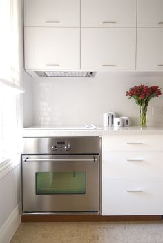 White kitchen, white counters, stainless appliances, #IncomeProperty