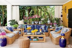 The terrace of this historic São Paulo house, whose decoration was overseen by architect and designer Sig Bergamin, features porcelain vessels from John Rosselli Antiques and a suite of wicker furniture.