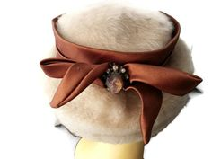 Vintage Faux Fur Hat Rust Satin Ribbon Rhinestones  Approximate Measurements :  Height - 3.5 inches  Outside - 7.5 inches by 9 inches  Hat band