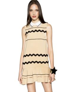"Make waves in this super cute beige Peter Pan collar tank dress. It has black wave ribbon detail on bodice, and contrast white collar. Featuring drop waist silhouette, ruffled peplum hem, and zip closure on back. This cute collar dress is not for special occasion only, rock it from party to everyday; just add platform shoes. *100% polyester*35""/89cm bust*34""/86cm waist*32""/81cm length*Measurements are taken from size small.*Model is wearing size small and model's height is 5'11""/180cm."