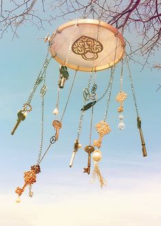 DIY Wind Chimes - now there is a use for those old 'what's this for?' Keys. To make them prettier, paint them, glue beads to the key head & even tie pretty ribbons on them.