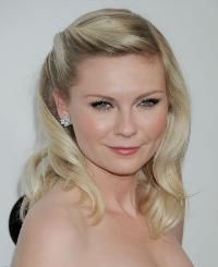 Kirsten Dunst We get it: It can't be easy for a bride to fully commit to an updo or a style worn down. Try out this half-updo worn by Kirsten Dunst on your indecisive clients who love the idea of a pin-up style but still want to keep things romantic and soft.