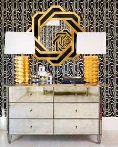 Textured+black-and-white+wallpaper+makes+a+bold+statement+in+this+boutique.+The+textured+gold+lamps+stand+atop+an+antiqued+mirrored+chest+that+is+as+stylish+as+it+is+functional.++