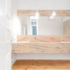 Rar Studio adds marble bathrooms in renovation of 19th-century Lisbon apartment