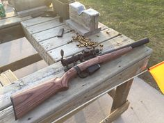 Modernized DeLisle Carbine Replica, derived from a SMLE. .45 ACP, integrally suppressed, uses 1911 magazines.