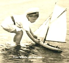 1909 Prussian Prince Wilhelm playing with pond yacht