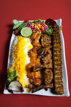 Farsi Cafe chef's special 3 pcs of lamb rack, 3 pcs chicken bone-in, skewer of ground beef served with rice and salad. Iranian Dishes, Iranian Cuisine, Middle East Food, Middle Eastern Recipes, Persian Kabob Recipe, Afghan Food Recipes, Iran Food, Beef Kabob Recipes, Cooking Recipes