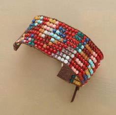 "Chan Luu weaves a rich pattern with tiny faceted beads of red coral, aquamarine, yellow jade, amazonite, amethyst, turquoise, lapis and carnelian, secured with leather end tabs and a sterling silver button. Fits 6-1/2"" to 8-1/2"" wrists"