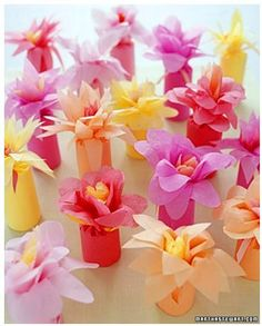 Flower-Wrapped Favors: Wrap favors in brightly colored tissue paper and top them off with a paper flower -- a low-cost alternative to the real thing.