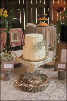 we could do a spray like this that would sit on top of the cake - I think a round one may not suit your square cake :)