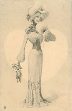 she stands facing front holding mistletoe & puppets dangling from her right hand, left hand to chin