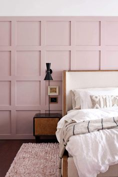 Pink paneled bedroom wall