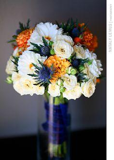 Orange, cream, white, and blue wedding bouquet.