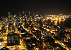 Seattle Downtown:  Night view of the well lit Seattle downtown from the space needle.