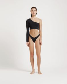 A black asymmetrical one-shoulder swimsuit top. Full coverage black swimsuit top with one shoulder long sleeve Black Swimsuit, Swimsuit Tops, Bikini Tops, Swimsuits, Bikinis, Swimwear, One Shoulder Swimsuit, Spandex Material, Black Tops