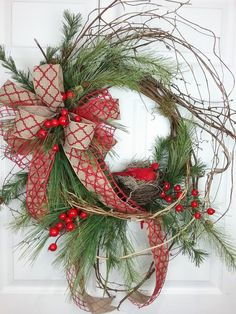 Christmas Wreath, Winter Wreath, Twig Wreath, Christmas Wreath with Cardinal  The base of this wreath is twig and I have added lots of pine and crabapples. I have woven honeysuckle vine throughout to give it a wild and woodsy look. The double bow is natural with a red design ribbon and an open mesh red ribbon. There is a nest with a cardinal in the middle. This wreath can be displayed all winter.  This wreath has a very natural look, yet I think it would go in all decors, even modern…