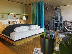 This hip hotel is located in the equally hip District 4 of Zurich, just a short walk from the main train station. The hotel has an eclectic style: zany bric-a-brac, including model boats, flamenco dancers and giant Duplo bricks, is arranged around the front desk, while truck tarpaulin bags, made by cult Zurich company FREITAG, dangle from the ceiling. Eclectic Style, Front Desk, Good Night Sleep, Guest Room, Switzerland, Flat Screen, Relax, Flooring