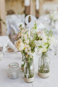 rustic centerpiece + table number, photo by Willlow & Co http://ruffledblog.com/belgenny-farm-wedding #weddingideas #centerpieces #tablenumbers