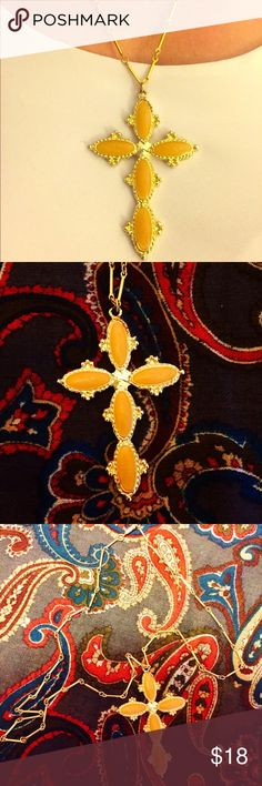"""Vintage Gold Cross necklace A beautiful vintage cross 3"""" in length that features light orange colored stones inlayed on a pressed gold colored cross.  Necklace is chain-linked and 25"""" in length. Jewelry Necklaces"""