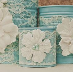 Painted tins, doilies and crafting flowers....this is such a super sweet wedding decoration idea!: