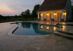 swimming pool at dusk http://www.gardendesigninc.com/