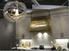 Kitchen: grey and brushed brass