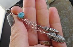 Turquoise Feathers and Chain Belly Button Ring, Turquoise Belly Button Jewelry. $20.00, via Etsy.