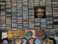 National Geographic Photo Contest. Music Collector: Ahmet is a record seller who loves music very much. He has a small and charming shop and he makes collection of long-play records. He spends his life on music and its changes, and he is very happy with the old melodies. Photo and caption by Melih Sular