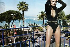 Love the belt, leotard & especially beautiful Cannes in the background
