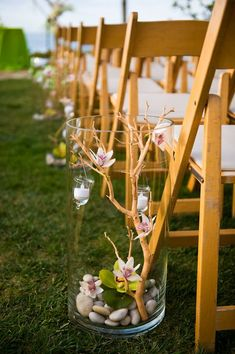 pebbles, orchids, candles arrangements for marking the aisle