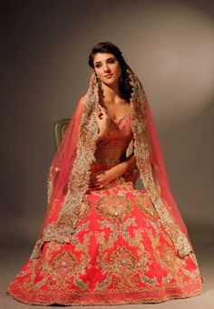 Velvet coral bridal lengha with gold silk blouse and hand embroidered coral net dupatta with silver and gold crystals, beads, silk thread and sequins