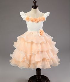 Add to the trousseau of your baby girl the gorgeous party dress. It comes with white bodice with stylish sleeves consisting of rose flowers in peach on neck and a floral motif on the waist.