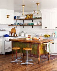 A wood and metal military desk-turned-prep island is excellent inspiration for the Modern Masters Metal Effects rust finish playfully mixed with a paint finish! This is the home of Coley Arnold as featured in Country Living magazine.