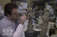 Trevor L. Hensley sculpts a pair of creature hands at Stan Winston Studio.