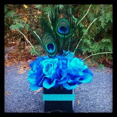 Peacock centerpiece by KreativeCreations11 on Etsy, $15.99