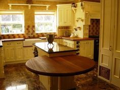 Low level iroko breakfast bar | Our Gallery | Our galleries | M D C Kitchens & Bedrooms | BT Tradespace