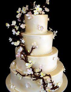 es mas elegante de arbolito orquidea blanco de pastel