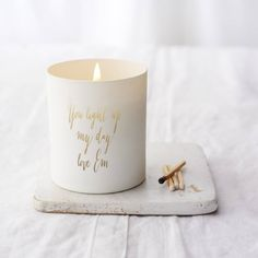 Personalised Message Candle. Beautiful white glass candle, personalised with your message. Inspired by cozy nights in by the fire, this beautiful hand poured candle blends notes of sweet cinnamon and clove with a dash of fresh orange.