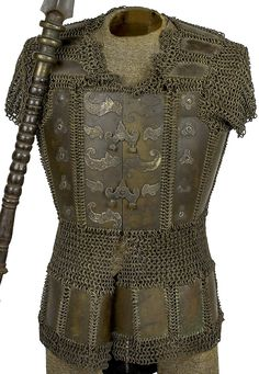 Moro (Philippine) brass mail and plate cuirass, 19th century, complete with bosses and metal furniture attached to the breastplate with two functional fasteners, back of the cuirass with scaled metal plates.