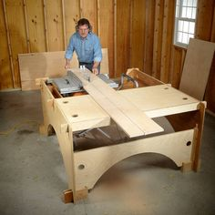 This DIY table saw table is the perfect solution for cutting long boards or big sheets of plywood. It's also a handy workbench with storage trays. When finished, a DIYer can quickly dismantle the table saw table and store it flat against a wall. Workbench With Storage, Table Saw Workbench, Table Saw Jigs, Diy Table Saw, Lumber Storage, Router Table, Workbench Plans, Craft Storage, Tool Storage