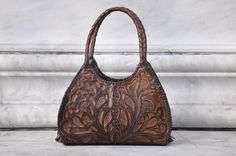 Hey, I found this really awesome Etsy listing at https://www.etsy.com/listing/466384816/stunning-tooled-leather-handbag-handmade
