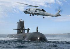 Royal Australian Navy Collins class submarine HMAS Sheean and Sikorsky S-70B Seahawk.