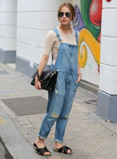 Annabel Rosendahl is wearing a denim overall from Current/Elliott, sand coloured top from FWSS, sandals from Isabel Marant and sunglasses fr...