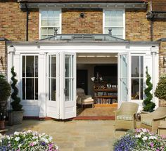 Conservatory with bi- folding doors