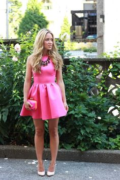 Opt for comfort in a deep pink skater dress. Opt for a pair of beige leather pumps to va-va-voom your outfit.  Shop this look for $59:  http://lookastic.com/women/looks/black-necklace-and-neon-pink-skater-dress-and-neon-pink-clutch-and-beige-pumps/3282  — Black Necklace  — Hot Pink Skater Dress  — Hot Pink Clutch  — Beige Leather Pumps