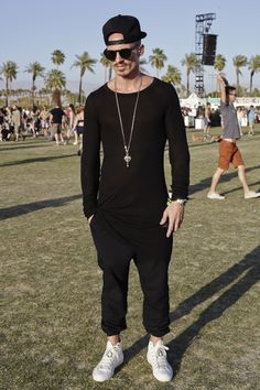 Fabien Desgroux from France, was one of many Coachella attendees who opted for a mostly black ensemble punctuated with accessories or a different color shoe. (Photo: David B. Torch for The New York Times)