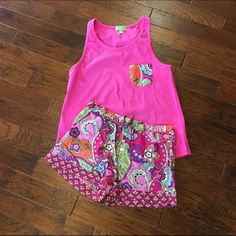 Vera Bradley 2 piece Pajama Set Adorable 2 piece Vera Bradley PJ set! Hot pink tank top w/ patterned pocket and matching shorts (: Size small and never been worn. The shorts have an elastic waistband with drawstring, 3 buttons & front pocket. Vera Bradley Intimates & Sleepwear Pajamas