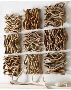 driftwood wall art (via pinterest) Lol looks like ramen on the walls.....